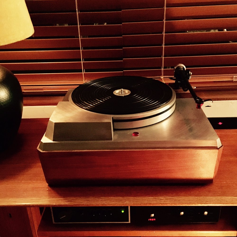J. Smallman System : Empire 298 turntable with Rega RB 303 tonearm, Dynavector 10x5 cartridge, Dynavector P75 phono pre, Naim NAIT -1, Rega DAC, Sonos Connect, Ryan R610 speakers.