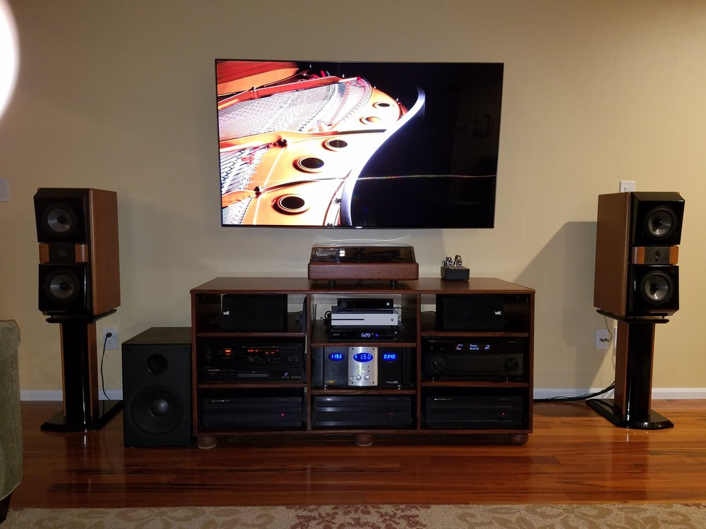 "Todd C System :  Yamaha CA-5100, 3 x B&K ST-1400 amplifiers, Monster AVS-2000 voltage stabilizer, Marantz DV-6600, Nakamichi DR-3, SOTA Star Sapphire Series 5 turntable, REGA RB-303 tonearm, Sumiko Virtuoso Boron MCC, Budgie tube phono preamp, X-Box One S, Nvidia Shield, JM Lab (Focal) Mini Utopia's (front), M&K S-85's (center), KEF Q70's (rear), Focal Cub (sub), Samsung 65"" 4k.  DANG!"