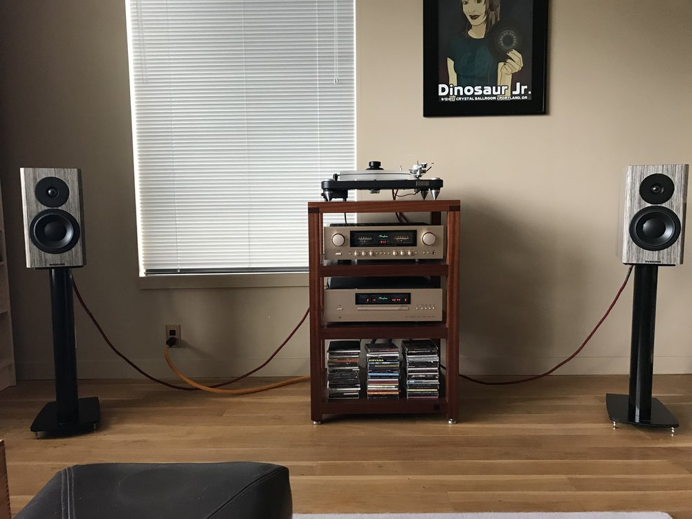 Brian F system (!):  Accuphase DP-430 CD player, Accuphase E-270 integrated amplifier, Accuphase AD-50 MM/MC phono board, VPI Aries Scout turntable, VPI JMW-9 tonearm, Hana SL phono cartridge, Dynaudio Special 40 loudspeakers, Dynaudio Stand 6 speaker stands, Luna Red speaker cables, Luna Orange AC cable, Mapleshade Ultra Minimalist AC outlet, Box Furniture Co. S4S hi-fi rack.   Behind rack: Luna Red RCA cables tonearm-to-amp, Luna Red XLR cables CD player-to-amp, Furutech e-TP66 Rhodium AC power distributor, Luna Mauve AC cables from distributor to amp & CD player, Volex AC cable from distributor to turntable motor