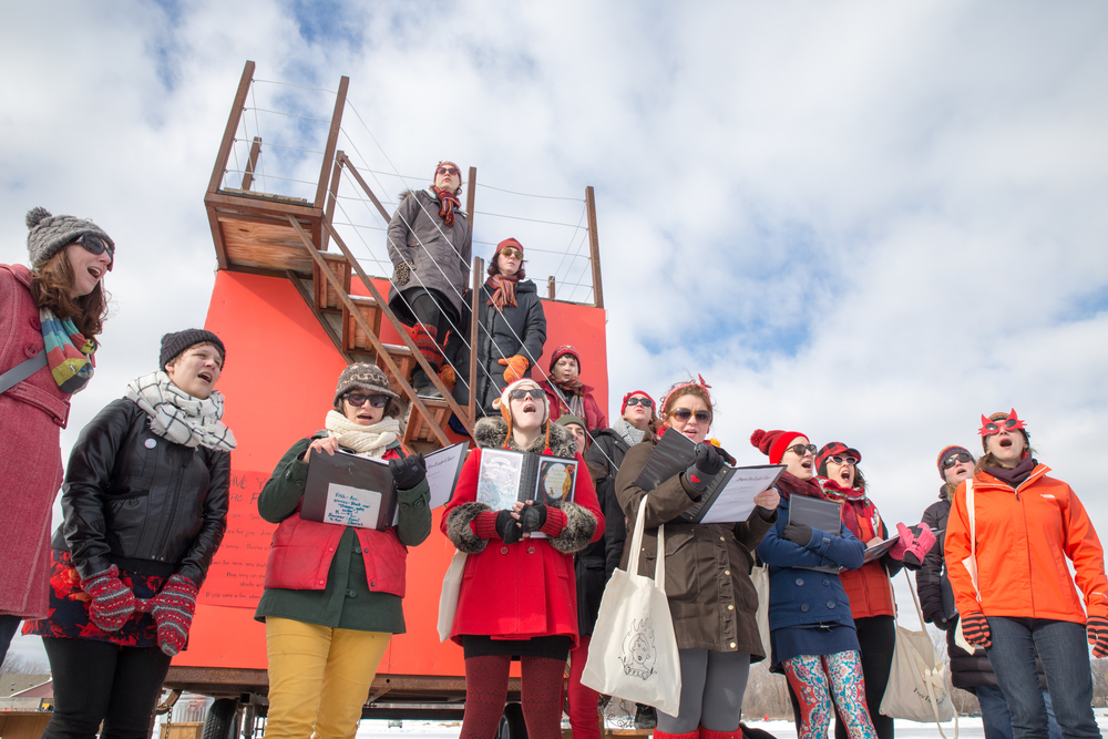 It is no surprise you feel warm all over when witnessing the Prairie Fire Lady Choir perform outside the Shanty of Joy + Necessity