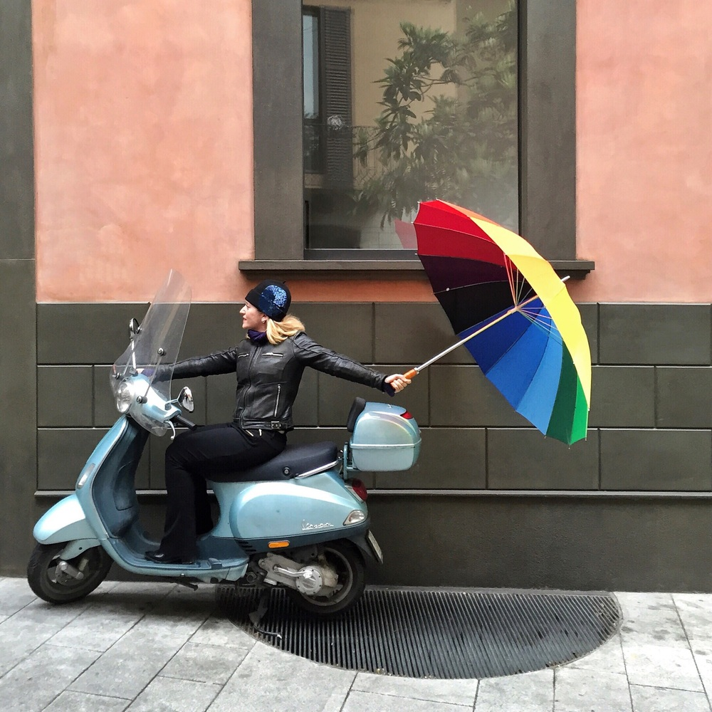 Photo of Annie with the brella in Milan, Italy. Captured by Andrea Tamburrini