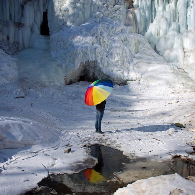Reflection- Eliana, 'brella and a puddle at Minnehaha Falls