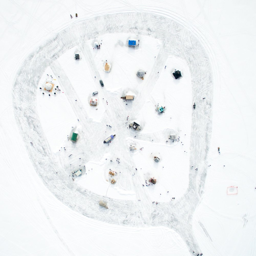 Art Shanty Projects 2016 Every year a group of artists create a village of shanties on a frozen lake. The village is only open for one month and is a very popular local festival. I am honored to be their official photographer