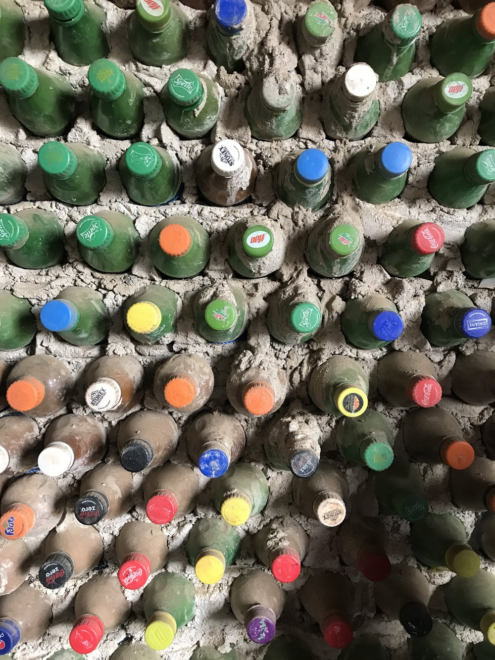 One of the leaders of Opprtunigee, Patrick, donated his own land for the artist collective building. They filled soda bottles with cement and made beautifully colorful walls!