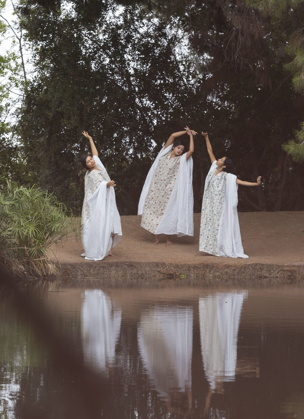 - Dressed in column-like caftans, the dancers evoke the trees behind them, moving slowly with the languid rhythm of nature.The caftan's architectural form reinforces the pattern's geometry, while the fluid dancers' movements mimic the loose brushstrokes that grow and fan from the cloth.