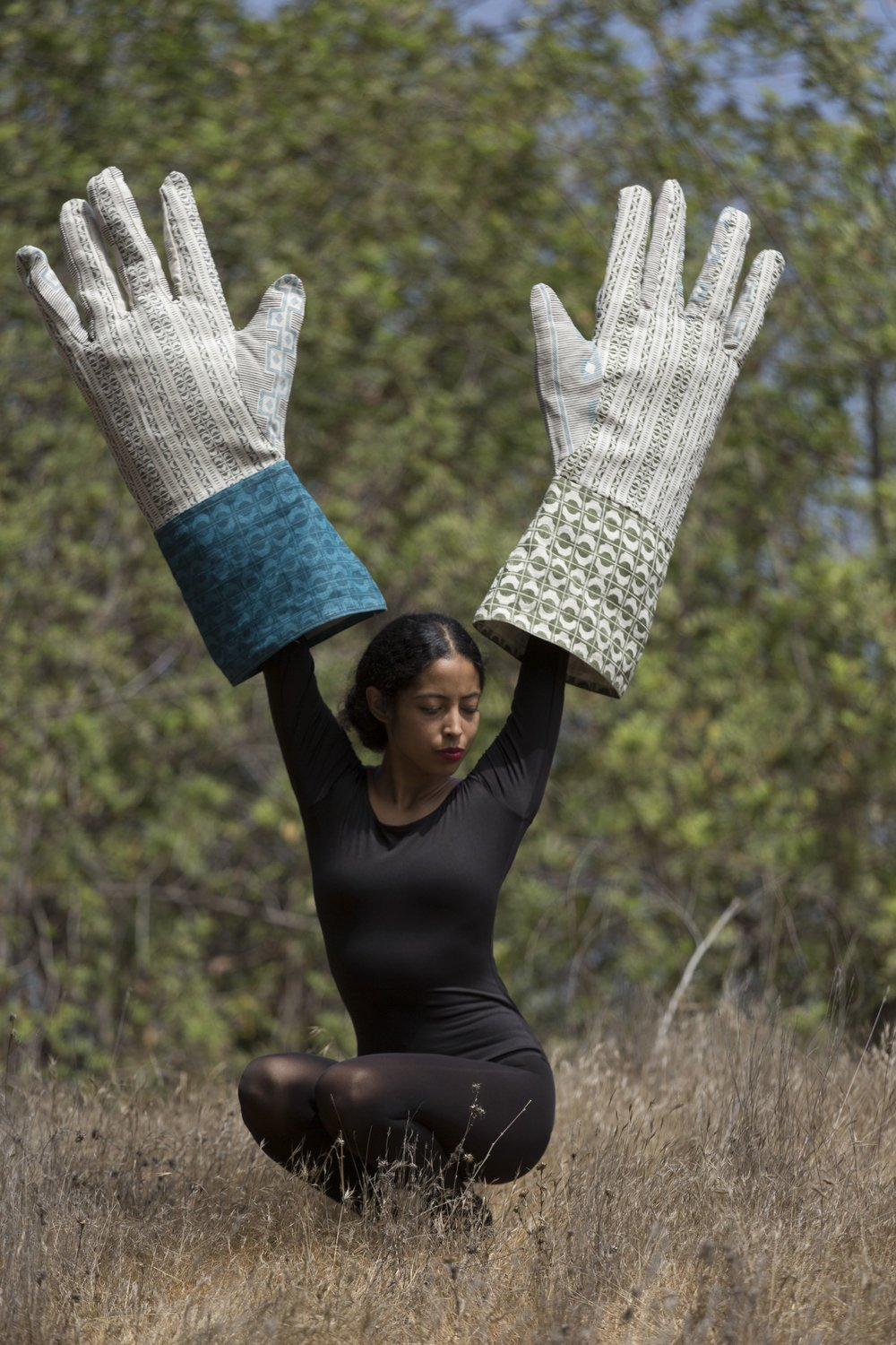 "- Inspired by the performance artist Sylvia Palacios Whitman's ""Passing Through"" (1977) as well as Bauhaus photography, these large-scale hands bring humor and history into the landscape.The hands are constructed from two BPT fabrics: SETO and ABUJA. Named for the inland sea that connects the islands of Japan, SETO is a series of intersections. East meets west, north meets south, ancient meets modern.Hand-screened in two shades of deep teal on Belgian linen, the hand-blocked grid holds open and opaque forms in balance.ABUJA is an exploration of color, cut, and repetition. Named for one of West Africa's busiest cultural hubs, the rhythmic pattern draws on a mix of West African and mid-century modern motifs."