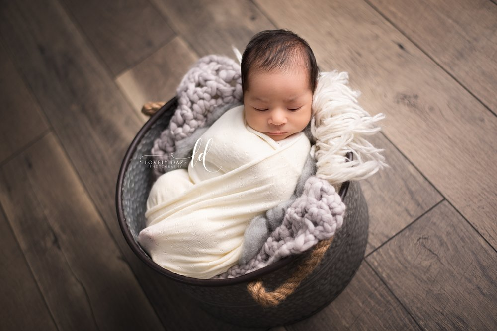 baby boy photography lovely daze photo nj studio  baby in bucket  swaddled baby