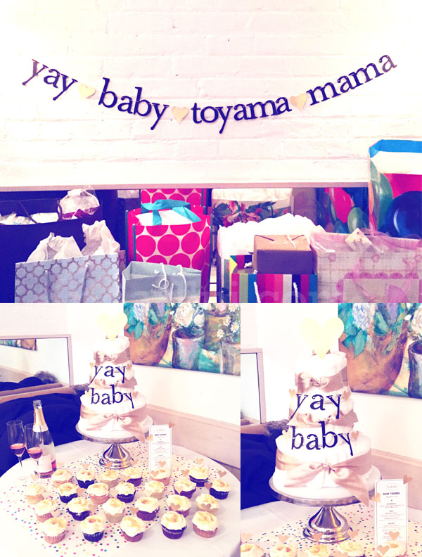 """Yay Baby"" Minimalist Baby Shower Party: Banner, diaper cake, and cupcake toppers."