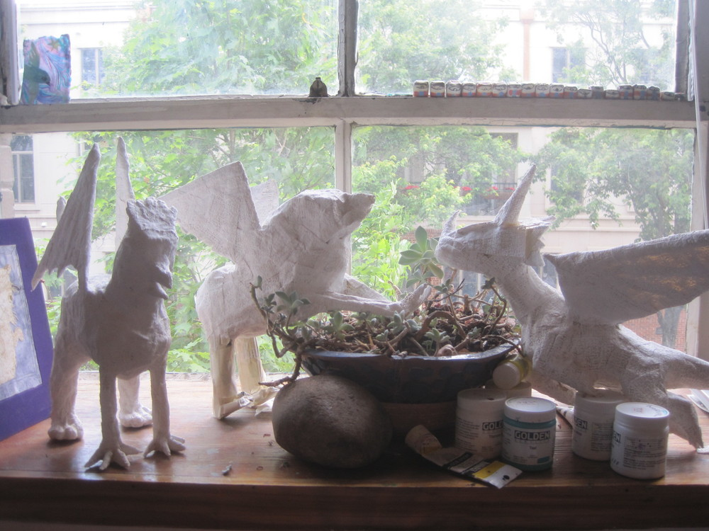 Plaster sculptures by myself and students. Two gryphons and a dragon.