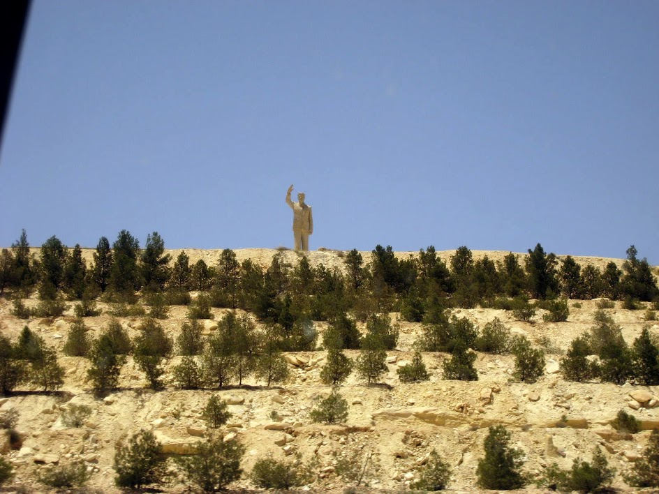 This statue of Hafez al-Assad greets you as you drive into the city.