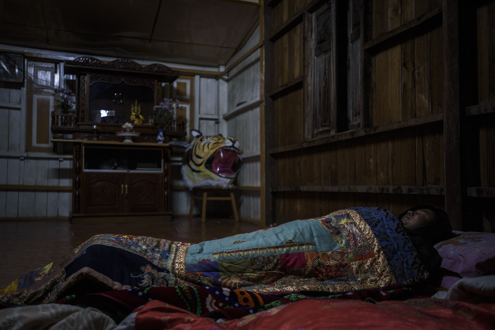 One Leng sleeps on the second floor of the SNLD headquarters in Lashio. Although he does not have all the results, he said he thinks he can win before bedding down for the night.