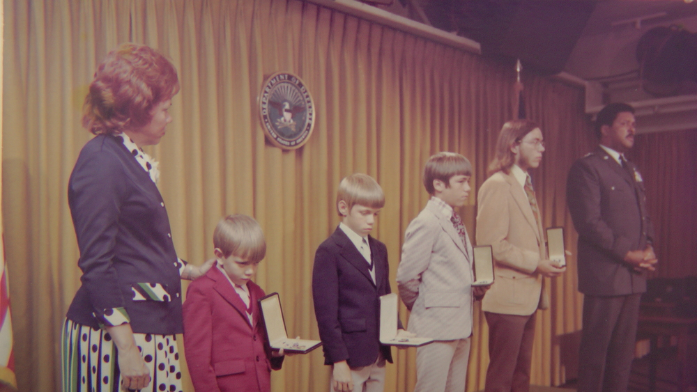 "The Grubb sons receive medals in honor of their father from General Daniel ""Chappie"" James, Jr."