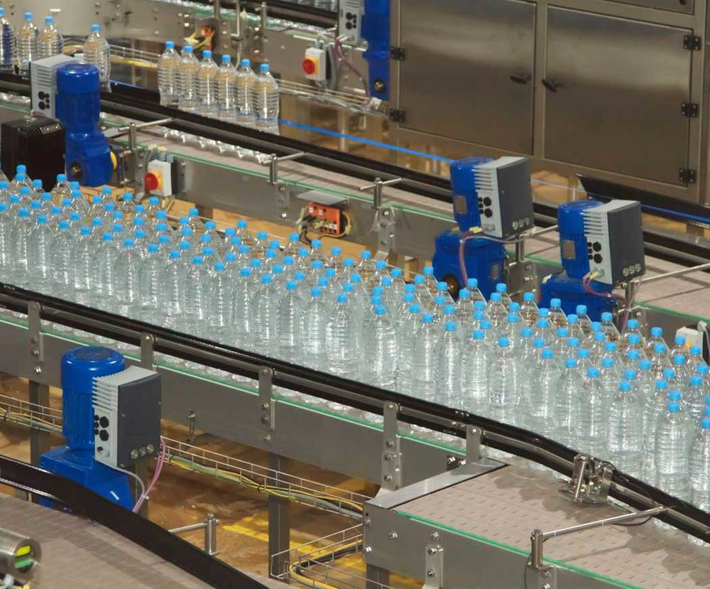 stock-photo-37554370-water-bottling-factory-with-bottles-on-conveyor.jpg