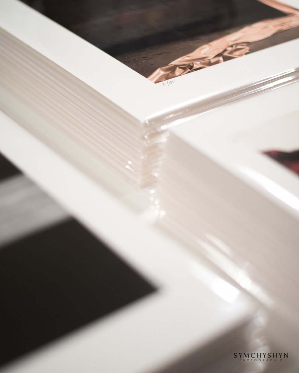 Here's stacks of completed images following signing and packaging.
