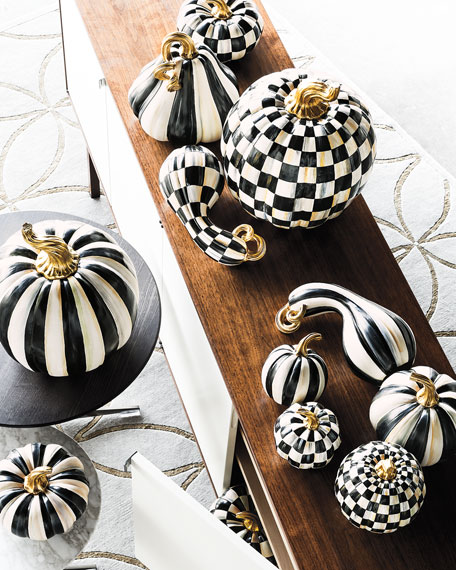 Black and white with simple stripes and a checkered pattern is both modern and timeless. Photo:  Neiman Marcus