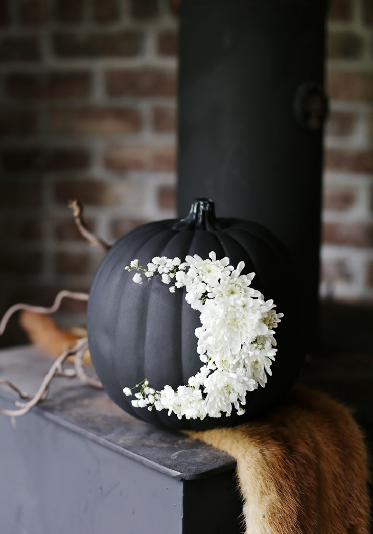 A black pumpkin is spooky but a floral crescent moon softens the look. Photo:  The Merry Thought
