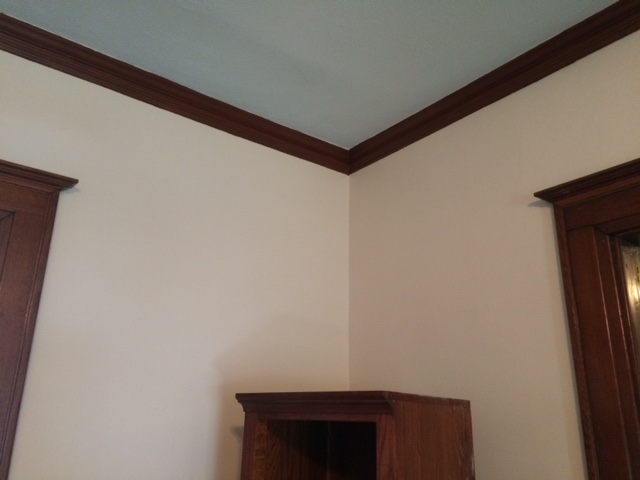 """The living room's blue ceiling. My sister suggested this. """"Iris,"""" by Sherwin Williams."""