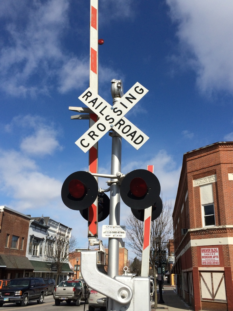 Nothing seems more right for a small, rural town than a railroad crossing in the middle of it.
