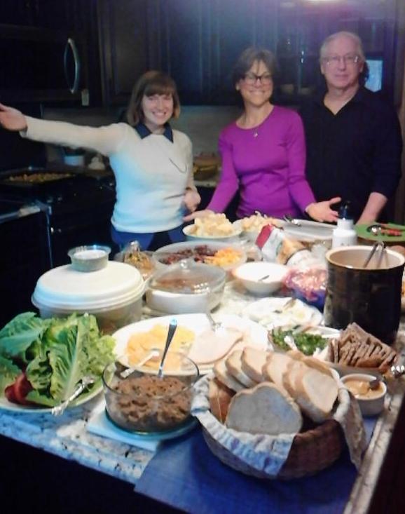 Tara Whitsitt, me and Mark before an awesome potluck spread. Photo courtesy ofMonty Siekerman/AdaIcon.
