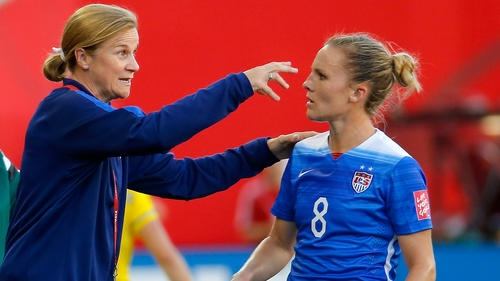 Ellis and Team USA forward Amy Rodriguez. Photo, courtesy of Kevin C. Cox/Getty Images.