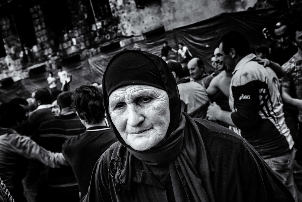 Despite being a mainly men tradition, women are not forbidden to participate in Lelo Burti. They do tend to act more as supporters or helping with injured men than being inside the big melee. Shukhuti, Georgia, April 2014.