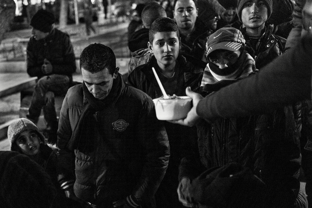Despite the low temperatures of the winter, single men that can not pay for an hotel spend the nights at the centric Victoria square. Thanks to private initiatives food is given everyday. Local government has refused to give any kind of help here in a move to eradicate their presence in the square. Athens, Greece, January 2016.