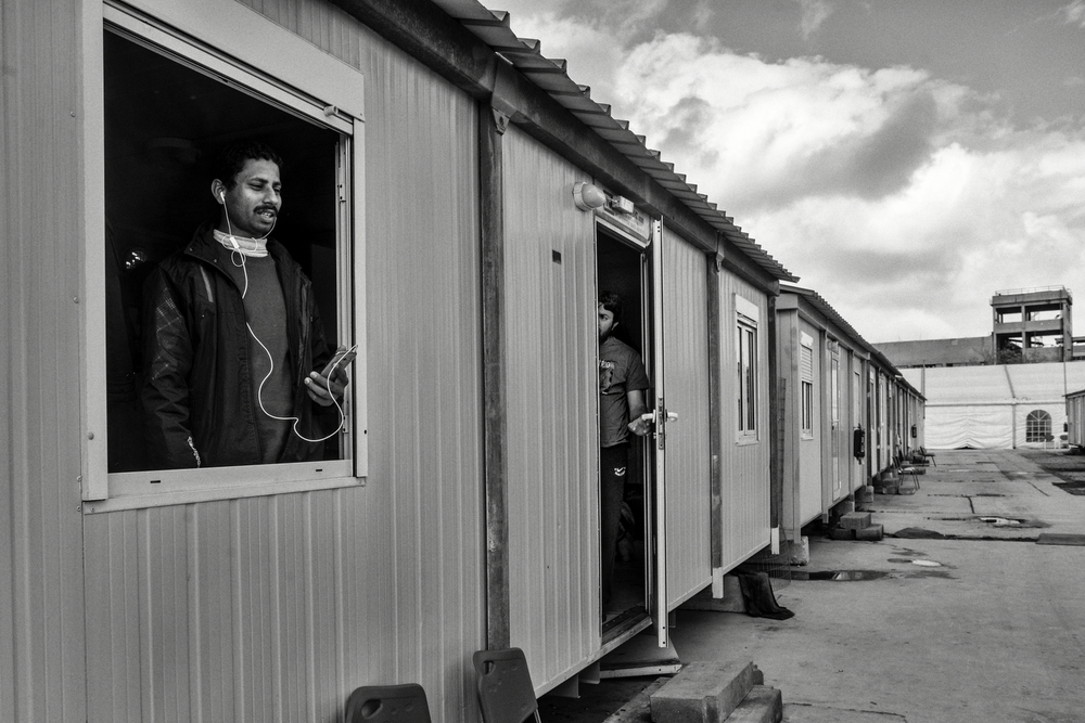M. is calling to his relatives from Pakistan. He shares a bunkhouse with other single men from Morocco and Iran. People stay on the camps with no other options than wait to being deported or to get the asylum status, a challenging process that can take weeks or months. Athens, Greece, January 2016.