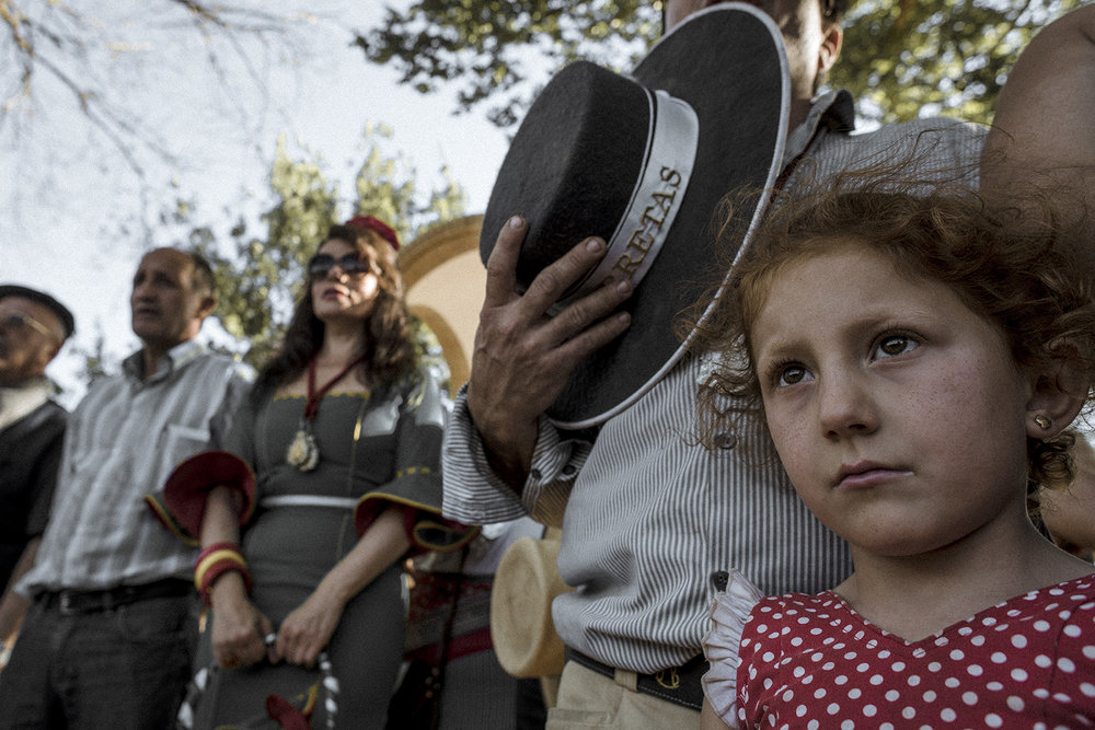 During each pilgrimage route there are known spots were pilgrims rest and perform dances, religious offerings or collective singing. A mix of South Spain folklore and religion. Hinojos, Spain, May 2015.