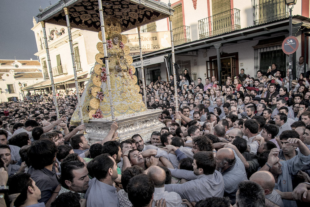 The next day after Pentecost's Sunday the brotherhood of Almonte exhibits the original Virgin Mary of El Rocío. An almost 12 hour non-stop parade in which people fights to touch or carry the statue. El Rocío, Spain, May 2015.
