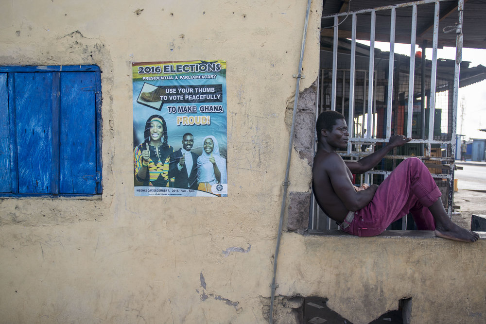 A man rest in a tailor shop on the neighbourhood of Teshie, Accra. As the country prepares for the incoming general election on 7th December, billboards and advertising promoting a peaceful election can be seen all around the city of Accra