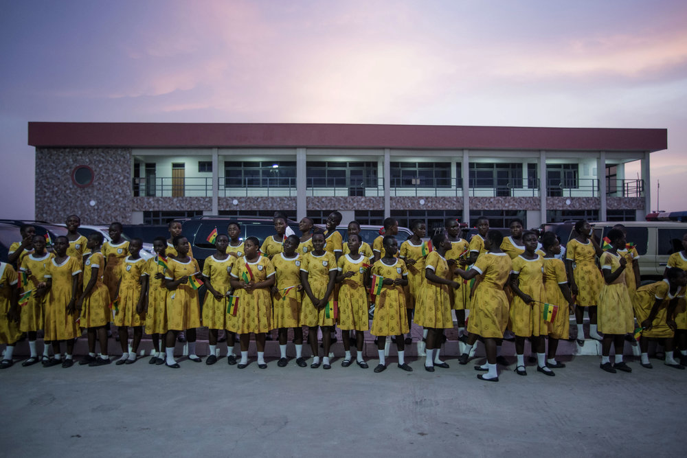Kids of the K.G St.Marys school wait for Ghana's president John Dramani Mahama during the opening of the new Bukom Boxing Arena in Accra