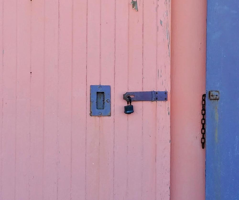 Blue Handle on a Rose Door