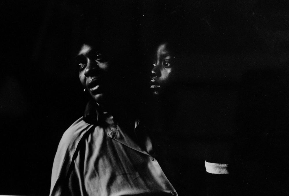 1994. Grandmother and caregiver to her grandchild, who was born with HIV. Both the child's mother and father died from AIDS, as did the child a few months after this photo was taken. Photograph by Bill Bayer.