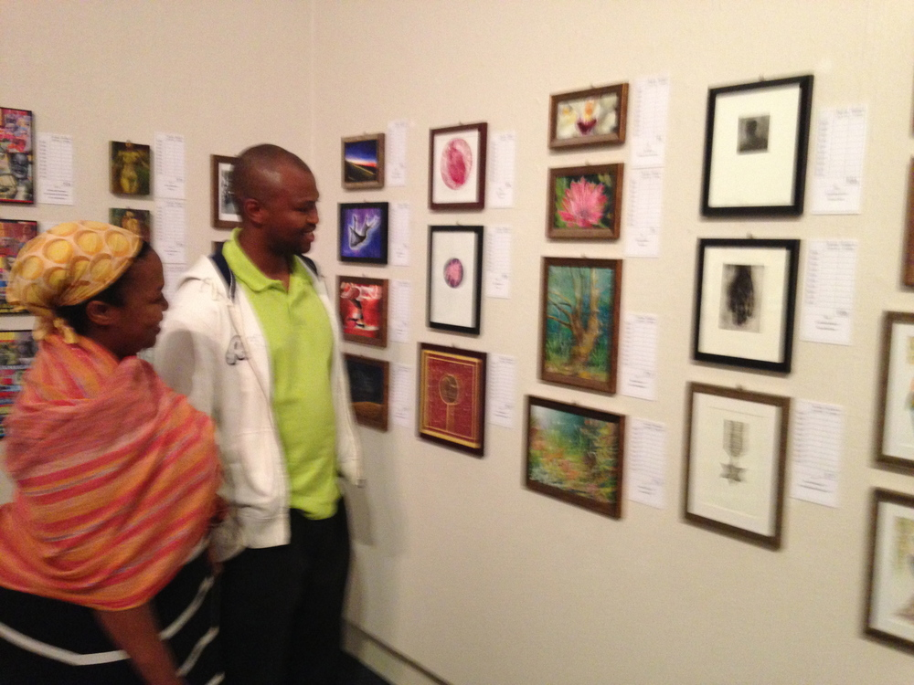 Guests admiring the artworks