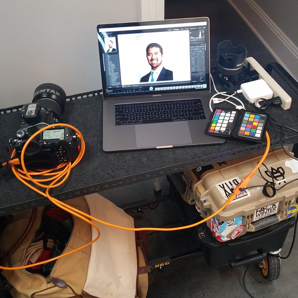"My Multi Cart R6G set up at a clients office for a headshot session. The cart was super valuable here because we did head shots in each of the partners offices, and then on a white seamless and then group shots in the ""bullpen"" having a mobile cart here was a game changer for productivity."