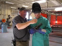 Welding Instructor Tucker Bauman (left) / Image courtesy www.oregon.gov