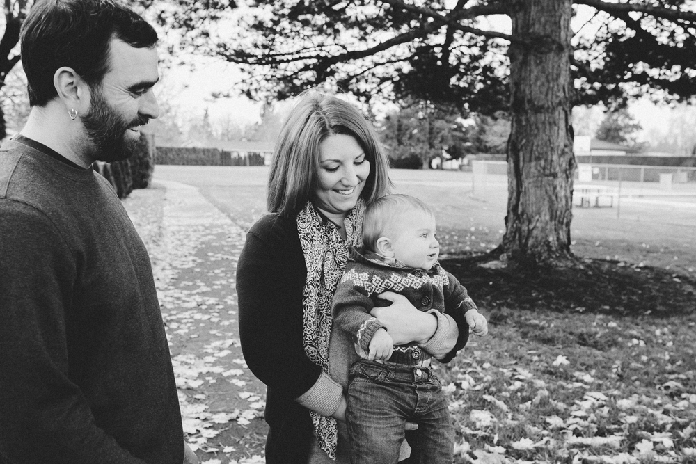 family admiring their first son