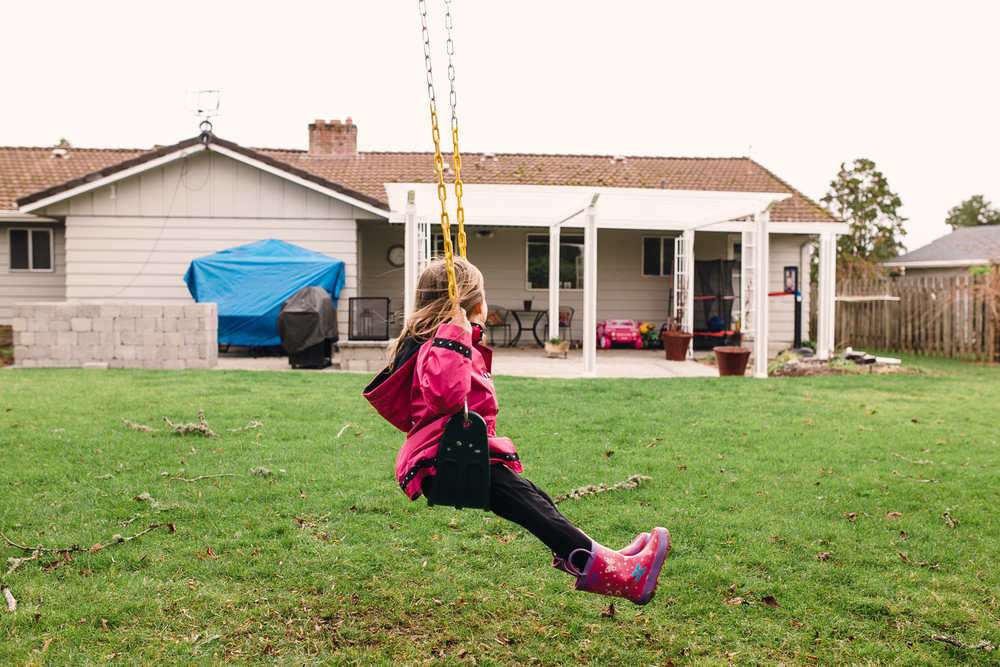 girl getting ready to swing