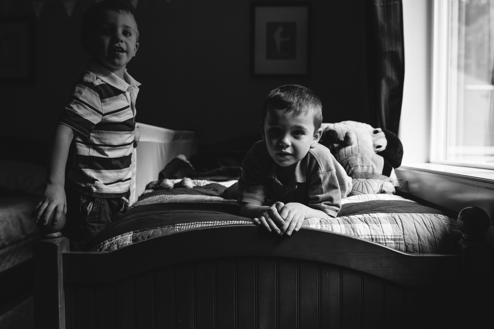 brothers laughing on their bed