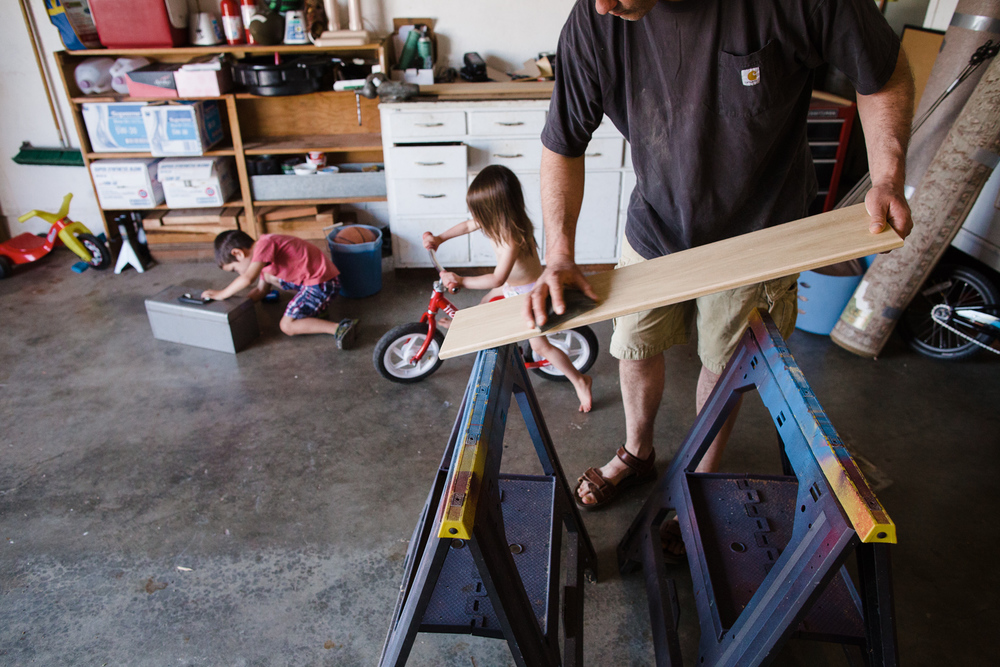 family making a bookshelf in the garage