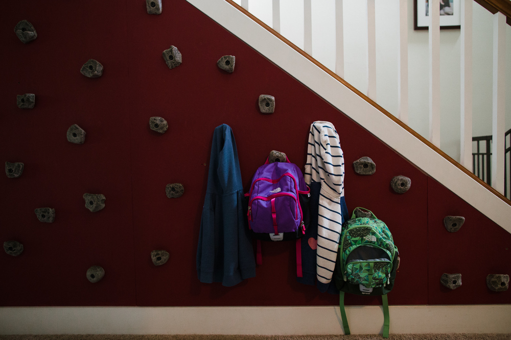 kids backpacks and jackets hanging