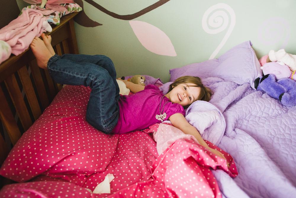 girl having fun on her bed