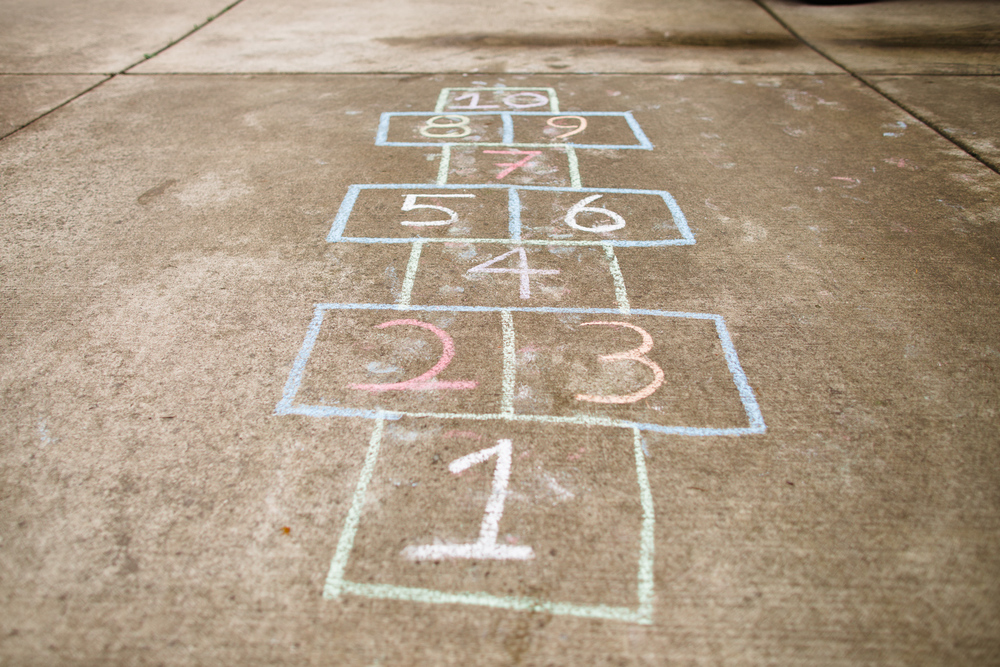 family made a hopscotch to play outside