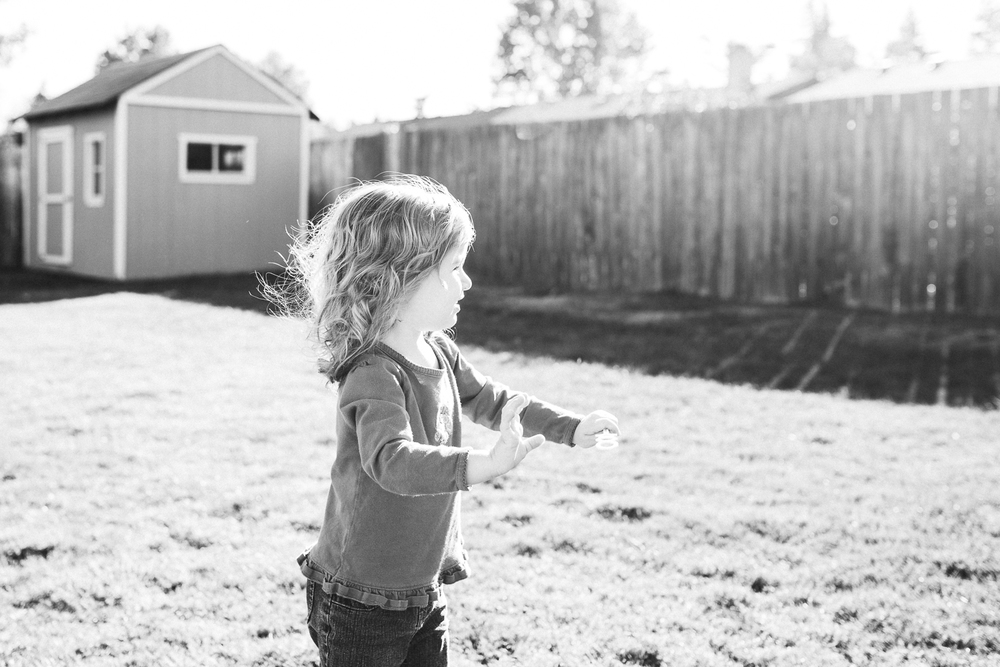 toddler playing in the backyard