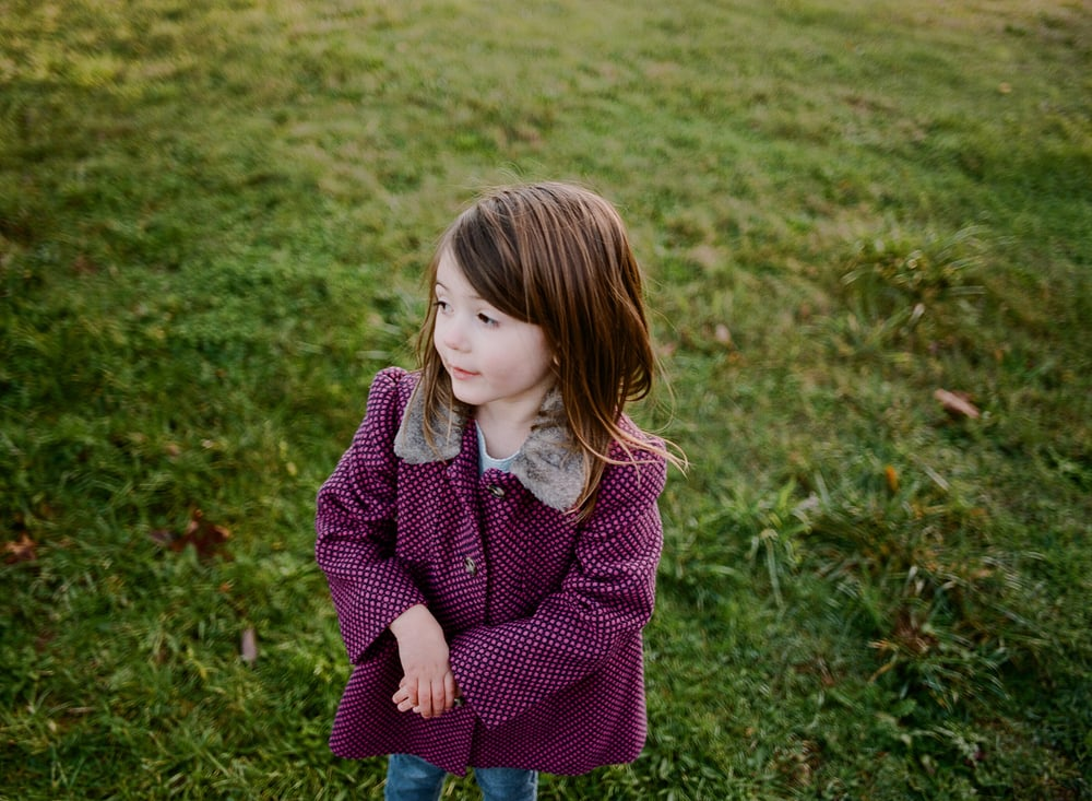 child with pretty purple jacket
