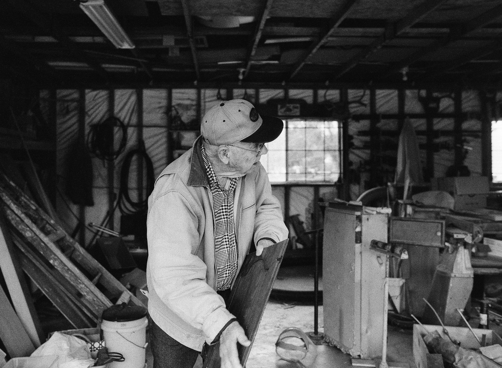 man working in his woodshed