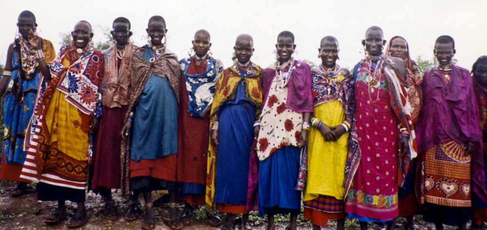 Members of the Maasai tribe welcome Dr. McGavin and his wife into their village. 1999