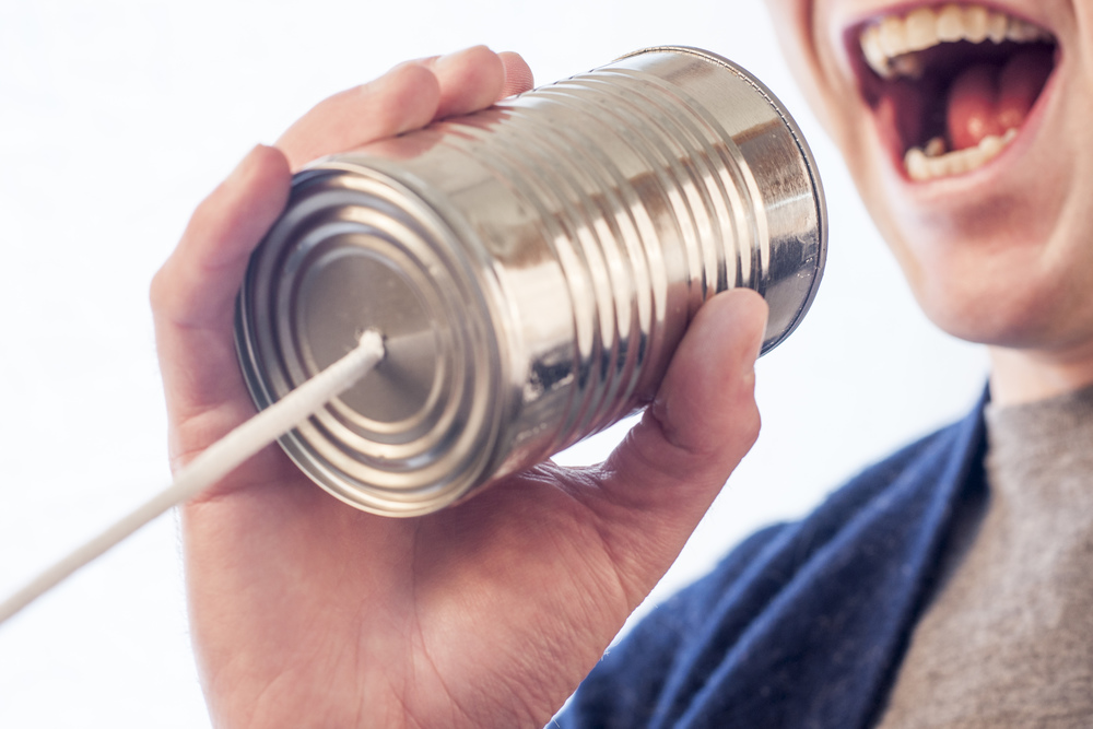 Man strategic selling communicating using a can