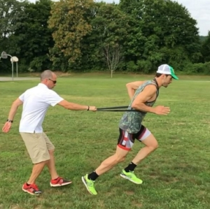 Coach Dave, and Theo, working on body position and foot-strike via tow-out drills.