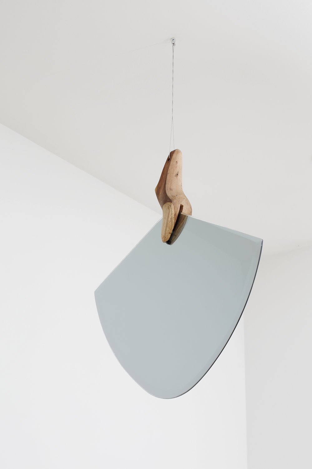 Omar Barquet ,  Pendular (Para C. Brancusi) , 2015,  modified mirror, carved and painted wooden shoe mold, thread